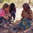 Claudia Bode learning how to weave from neighbors in the community. Photo: Courtesy of Claudia Bode and the MIT Public Service Center.